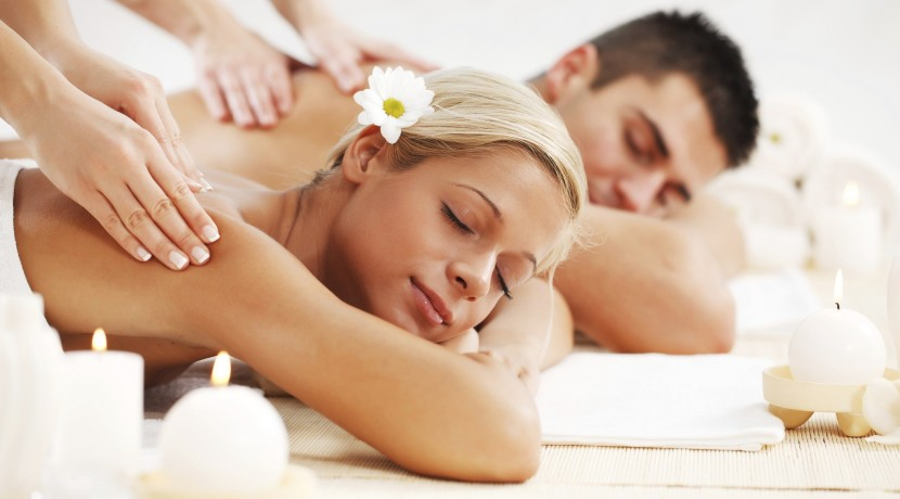 Beautiful couple enjoying in the back massage.